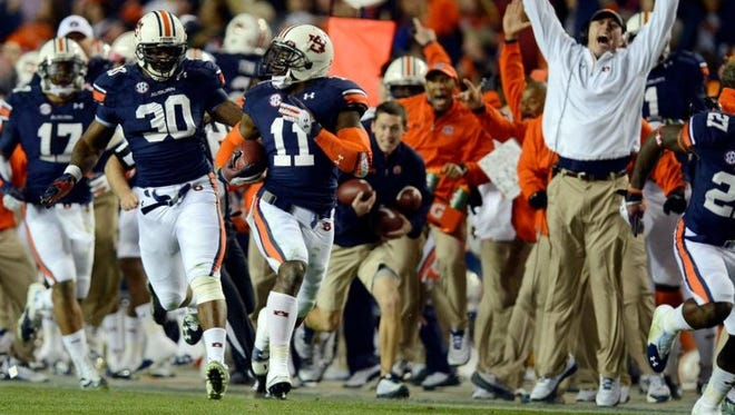Auburn cornerback Chris Davis returns an Alabama last-second missed field goal 100 yards for a touchdown in the Iron Bowl at Jordan-Hare Stadium on Saturday.  PHOTOS BY AMANDA SOWARDS/ADVERTISER