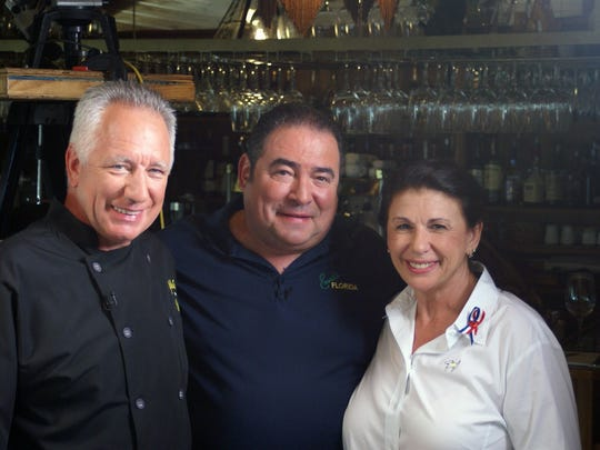 In this file photo, Stuart and Nancy Borton, owners of Yellow Dog Cafe in Palm Bay, pose with television personality and chef Emeril Lagasse.