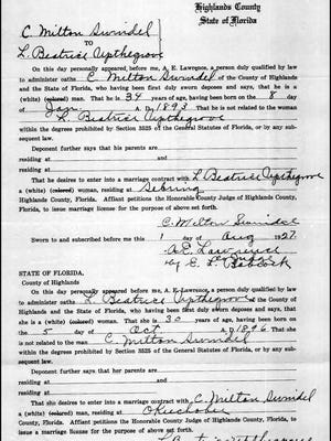 The marriage certificate of Charles Swindal and Laura Beatrice Upthegrove in 1927.