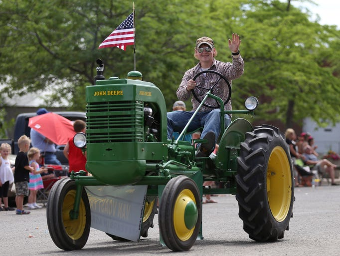 Brent Van Voast rides his John Deere tractor during the parade in Geraldine on Saturday afternoon, July 5, 2014.