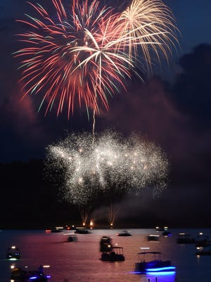 Fireworks explode over Norfork Lake during the 30th Annual Independence Eve Fireworks show on Friday, July 3, 2015. At least five fireworks shows are planned for the coming nights.