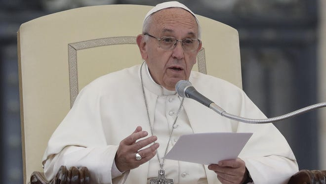 Pope Francis delivers his speech Wednesday during his weekly general audience in St. Peter's Square at the Vatican.