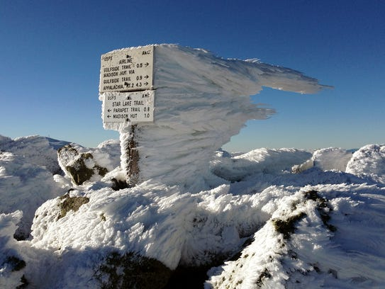 Rime ice extends several feet horizontally from a sign