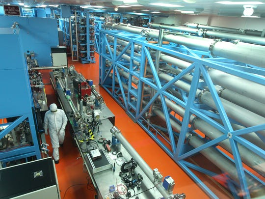 A worker in the Omega 60 laser bay at the University of Rochester's Omega Laser Facility.