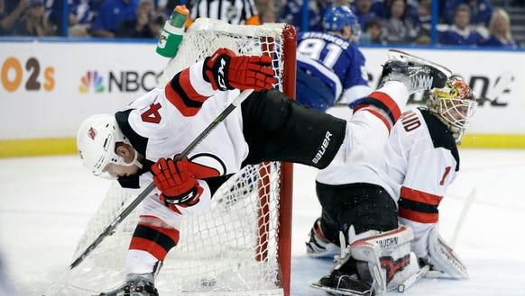 New Jersey Devils defenseman Sami Vatanen (45) collides