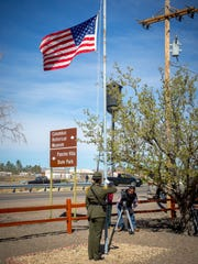 U.S. Border Patrol El Paso Sector Honor Guard member Alma Garcia salutes after raising the American flag during a ceremony commemorating the 100th anniversary of Pancho Villa's raid on Columbus March 9, 2016.