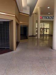 An empty store front is seen beside one of Macy's side