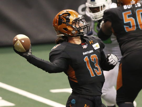 Arizona Rattlers' Jeff Ziemba (13) throws a pass against