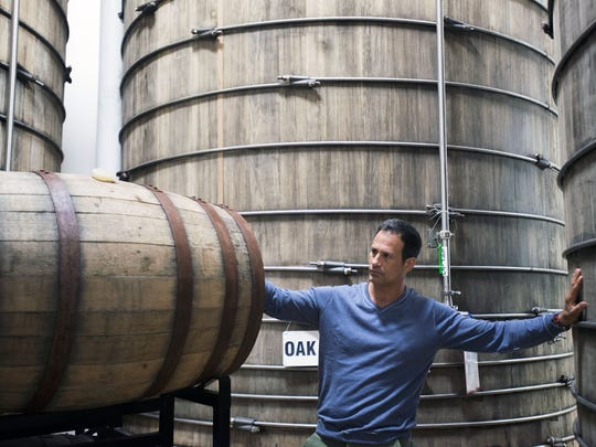 Dogfish Head founder Sam Calagione checks on barrels