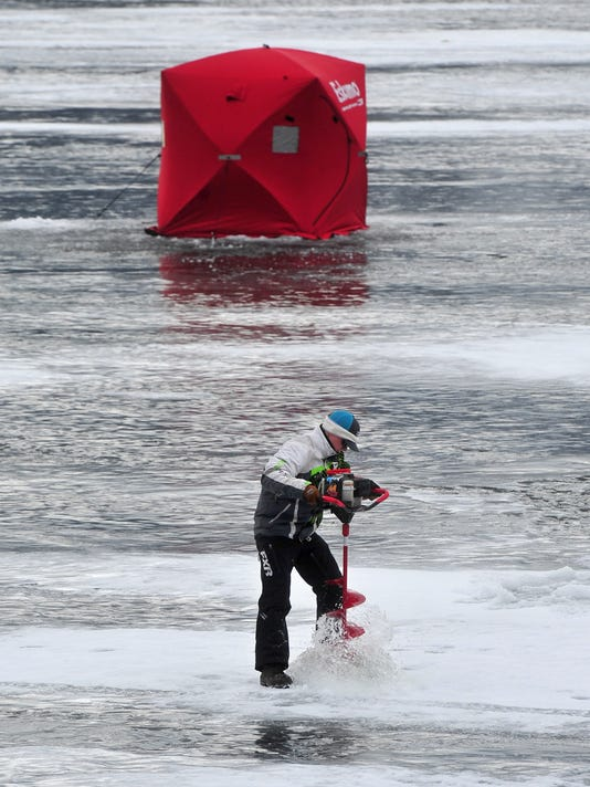 636522488843055919-ice-fishing-drilling.jpg