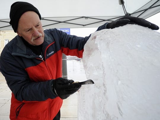 Ice sculptor Jeff Olson, of Egg Harbor, carves a maritime