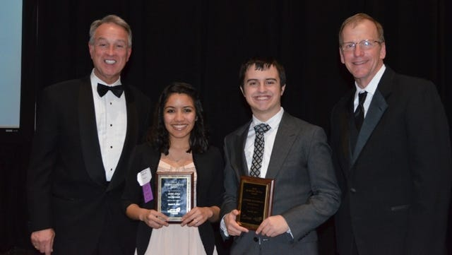 Heyra Avila, who won a Student Leadership award, and Connor Hutcherson, who is an Academic All Star, who both attend Ryle High School, are honored at the Excellence in Education Celebration. With the students are Boone County Judge-executive Gary Moore, left, and Randy Poe.