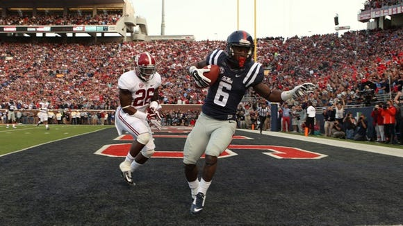 OXFORD, MS - OCTOBER 4: Jaylen Walton #6 of the Ole Miss Rebels catches a touchdown pass against Landon Collins #26 of the Alabama Crimson Tide on OCTOBER 4, 2014 at Vaught-Hemingway Stadium in Oxford, Mississippi. Mississippi beat Alabama 23-17. (Photo by Joe Murphy/Getty Images)