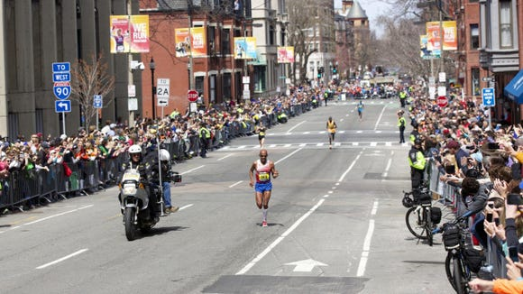 Meb Keflezighi in the home stretch in Boston's Hereford Street in the Back Bay.