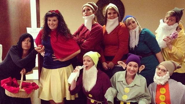 Oklahoma City-based reader Karee P. told me her office dressed up as Snow White and the Seven Dwarfs today. (There's also an evil witch on the left.)