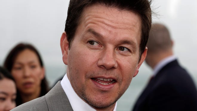 """Mark Wahlberg arrives for the world premiere of the movie """"Transformers 4: Age of Extinction"""" in Hong Kong."""