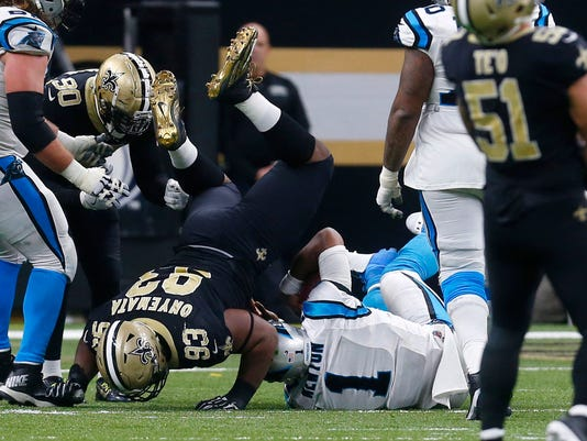 Carolina Panthers quarterback Cam Newton (1) is sacked by New Orleans Saints defensive tackle David Onyemata (93) in the second half of an NFL football game in New Orleans, Sunday, Jan. 7, 2018. (AP Photo/Butch Dill)
