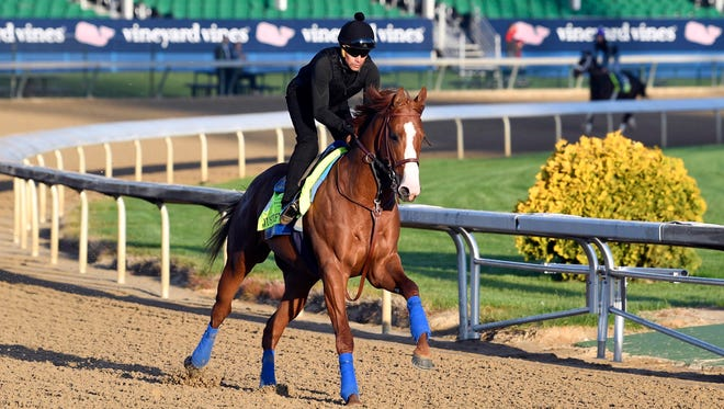 An exercise rider works out Kentucky Derby favorite Justify at Churchill Downs on May 1.