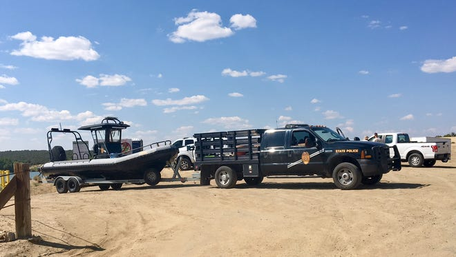 A New Mexico State Police boat and vehicle were part of the recovery effort Saturday for a man who drowned Friday night in Farmington Lake.