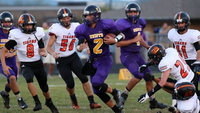 Unioto's Clay Edler rushes against Waverly during Week 3 of the regular season at Unioto High School. Edler and the Shermans will make the school's first playoff appearance this Friday at Cincinnati Wyoming.