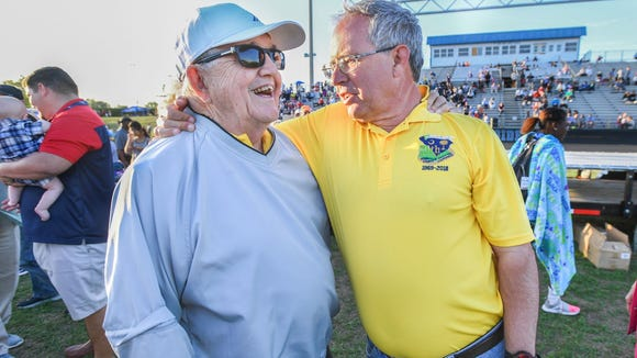 Former long-time Eastside cross country and track coach Ed Boehmke, right, shares a laugh with Jim Mattos, former long-time coach at Berea, after a ceremony in which Eastside's track was named after Boehmke during the 50th Greenville County Track and Field Championships Wednesday at Eastside.