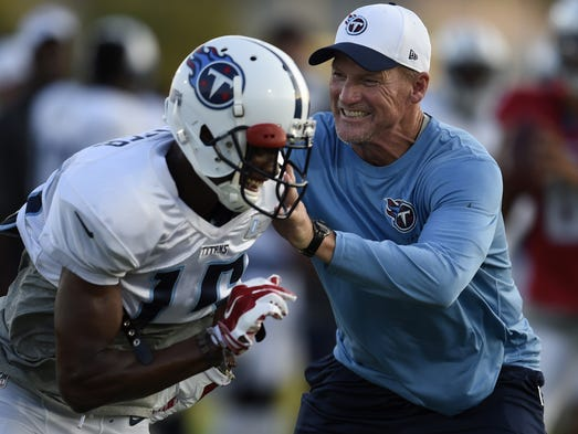 Titans head coach Ken Whisenhunt has fun as he defends