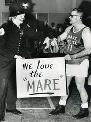 Mansfield Patrolment Joe Schivinski, costumed as a clown, and former Mansfield Mayor Richard A. Porter during his first year in office, 1972. Porter served as a local sports official for many years.