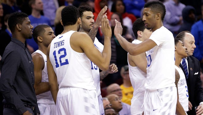 Kentucky players celebrate after a 78-39 win over West Virginia in a college basketball game in the NCAA men's tournament regional semifinals, Friday, March 27, 2015, in Cleveland. Kentucky improved to 37-0 and will play Notre Dame in the regional final Saturday. (AP Photo/Tony Dejak)