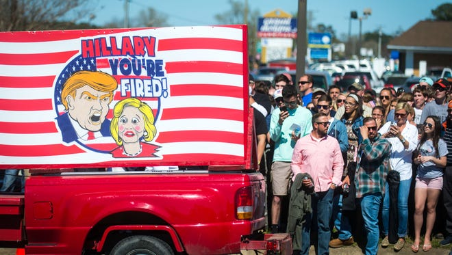 Donald Trump supporters wait to cross the street prior to a rally held at Stephen Decatur High School on Wednesday, April 20 in Berlin.