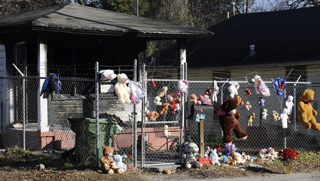 A makeshift memorial for two children, who died in a Friday Jan.16, 2015 fire, is seen at 751 Alexander Street in Montgomery, Ala. on Tuesday Jan. 20, 2015.