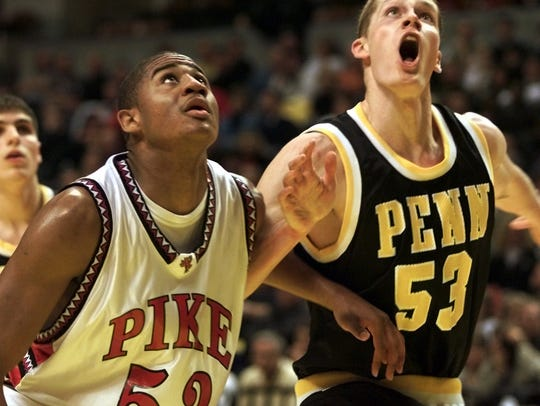 Pike's Parnell Smith (left) looks for a rebound during