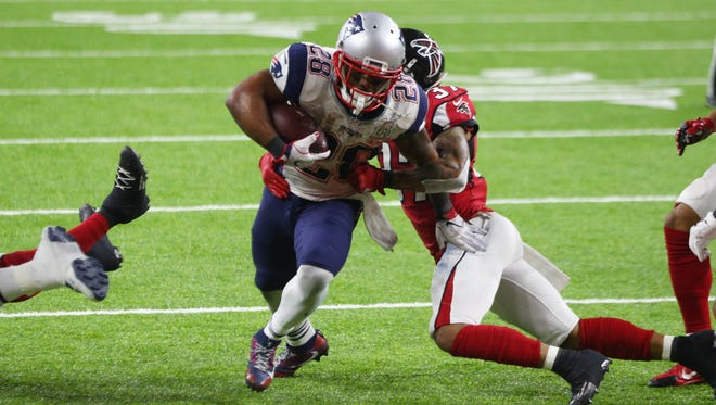 New England's James White scores the game-winning touchdown on a 2-yard run in overtime of Super Bowl LI. White, the former Badgers star, had a Super Bowl-record 14 catches for 110 yards and a touchdown and also rushed for 29 yards and two touchdowns.