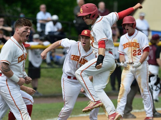 Bergen Catholic players celebrate a run in the game against Don Bosco at the Bergen County Baseball Tournament Finals in Demarest.