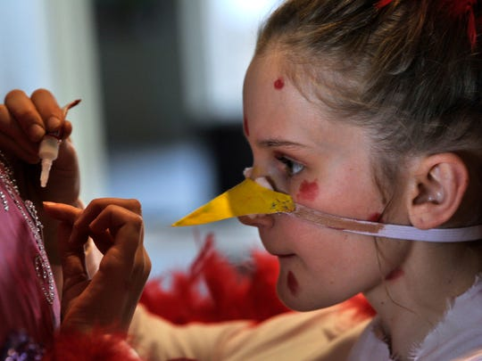 Lainey Roberts, 12 and dressed as chicken pox, adds some last-minute costume touch-ups to an Abilene Christian Schools teammate during Destination Imagination Saturday Feb. 24, 2018 at McMurry University. The ACS kids put on a musical performance featuring viruses.