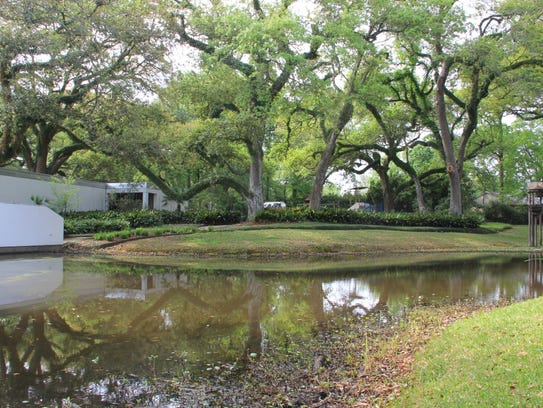 Water and lush green gardens surround this prime property.