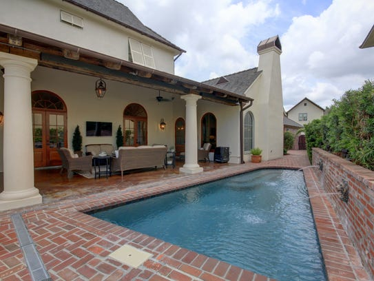 The pool and outdoor living area are picture perfect.