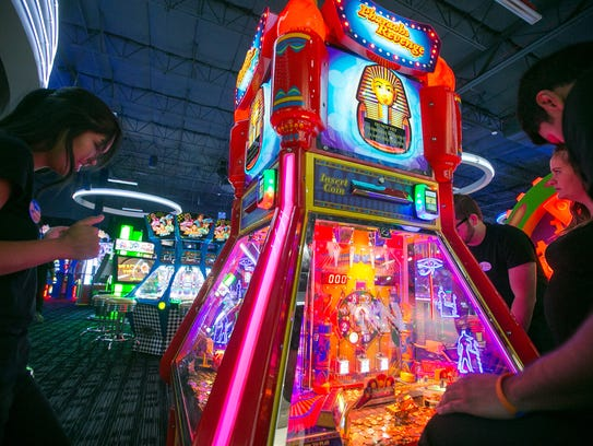 Employee Joyce Ocbina tries out an arcade game at the