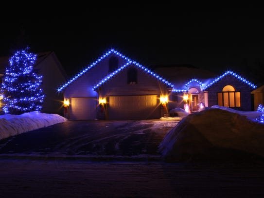 Blue holiday roofline lighting by Emerald Companies