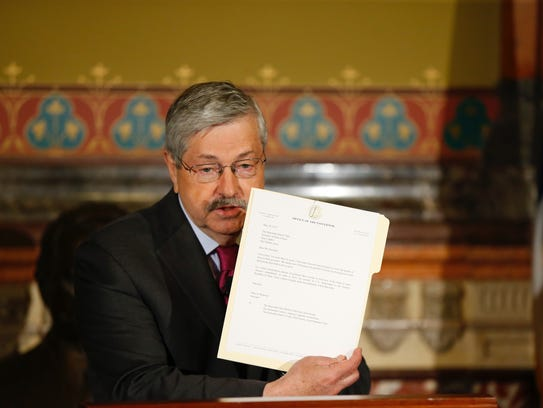 U.S. Ambassador Terry Branstad holds the letter indicating