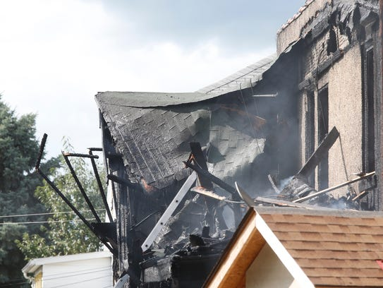 A structure fire broke out on Miles Street Friday afternoon.