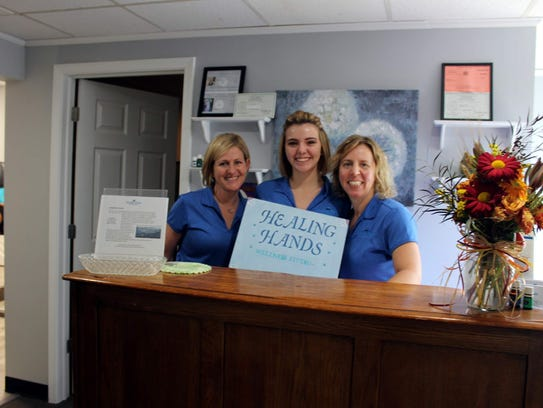 Owner Julie Hobart and staff members Kalie Young and Jennifer Susa of Healing Hands Wellness Studio on School Street in Victor. The studio will introduce its latest expansion at an open house on Tuesday, Nov. 14.