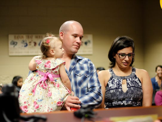 Earl and Danielle Keopsel wait for the judge to finalize