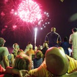 Spectators watch fireworks during the Sugar Mill Pond Independence Day celebration last year.