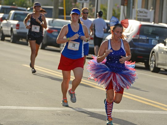 Runners make their way to the finish line during last year's Ronald McDonald House Firecracker 5K.  This year's event is June 30.