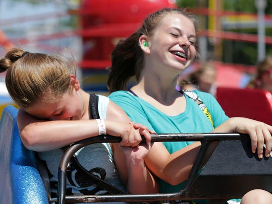 Madison Senso (left) and Kadie Biese laugh while riding the Sizzler at last year's Outagamie County Fair in Seymour.