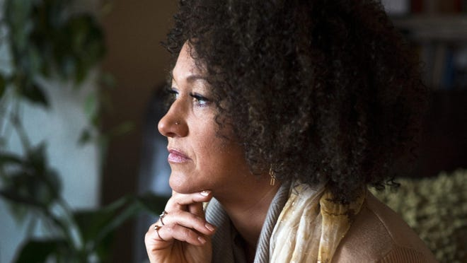 Rachel Dolezal, former president of the Spokane, Wash., chapter of the NAACP, poses for a photo in her Spokane home. Dolezal is facing questions about why she lied about her racial identity.