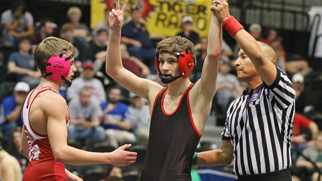 Rossville's Zach Archer holds up the number two with his hands after winning his second state championship in the 3A-1A 113-pound championship match Feb. 29 in Hays.