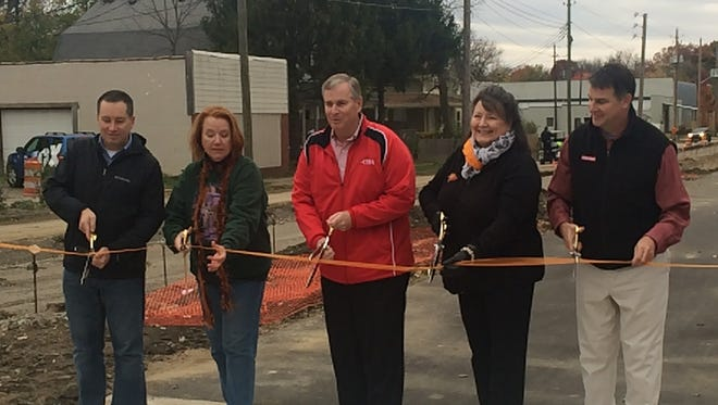 Mayor Greg Ballard (center) and Irvington residents cut the ribbon to the new greenway, an extension of the Pennsy Trail, that now connects the Eastside neighborhood to Downtown Indianapolis.
