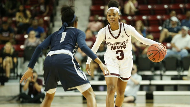 Myah Taylor looks to make a move against a defender in MSU's preseason exhibition.