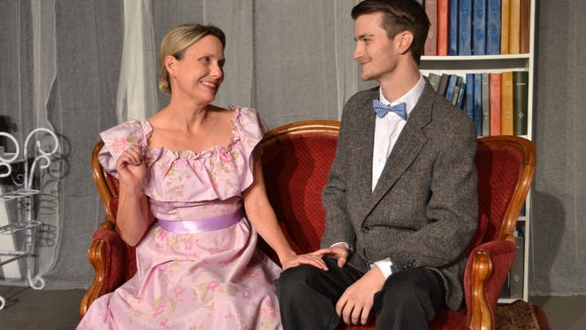 """Erika Stone plays the meddling mother Amanda who is stage-managing a date with a """"gentleman caller"""" (Bradley Gay) in Theatre Tallahassee's production Tennessee Williams' classic """"The Glass Meanagerie."""""""